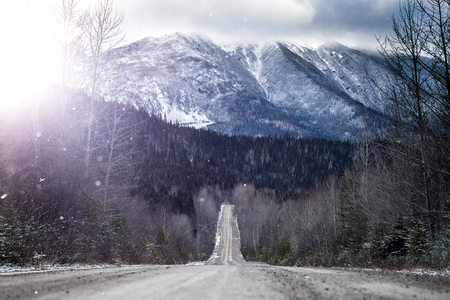 Winter Straight Road with Beautiful Snowy Mountains in Background