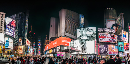 NEW YORK, USA - October 14, 2016. Crowded Times Square High Resolution Panorama at Night and LED Advertising Lighting up the Place in Manhattan, New York Sajtókép