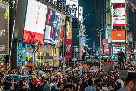 NEW YORK, USA - October 14, 2016. Crowded Times Square at Night and LED Advertising Lighting up the Place in Manhattan, New York Editorial