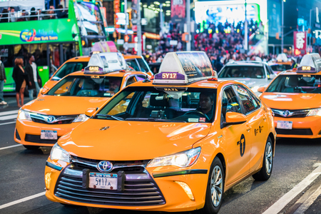 NEW YORK, USA - October 14, 2016. Details of Ywllow Cabs in the Middle of Times Square at Night, Manhattan, New York