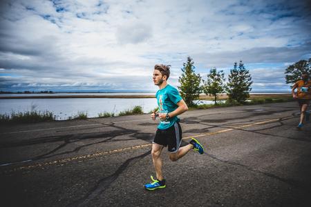 CARLETON, CANADA - June 4, 2017. During the 5th Marathon of Carleton in Quebec, Canada. Man Marathoner Sprinting the last 500m before the Finish Line