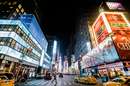 adds: NEW YORK, USA - October 17, 2016. Timesquare at Night with Bright Adds and Yellow Cabs