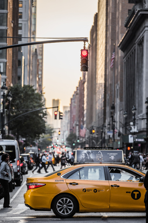 NEW YORK, USA - October 18, 2016. Lexington Crowdy Avenue in Manhattan at around 5PM on a Red Light Intersection.