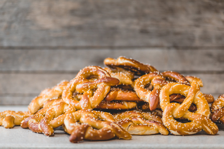 Stack of Fresh Pretzels on the counter top with Rustic background