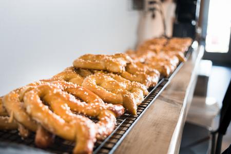 Close-up fresh baked tasty pretzels with salt Display.