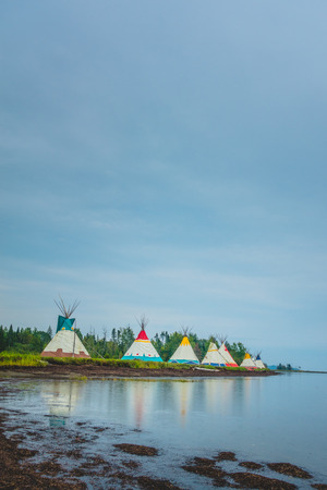 Traditional houses of native Americans installation in Gesgapegiag city, Quebec, Canada.