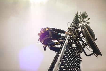 Telecom Worker Climbing Antenna Tower