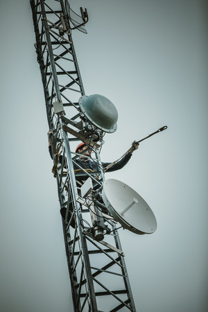 Telecom Worker Cliping Carabiner Harness for Safety on Antenna Tower Stock Photo