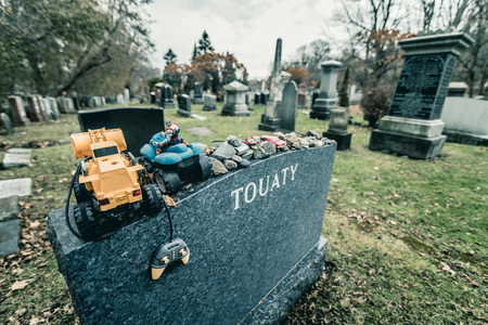 Montreal, Canada _ November 30, 2017. Jewish Tombstone with lots of stones and toys on it. The Shaar Hashomayim Cemetery was established in the mid-1860s on the northern slope of historic Mount Royal.