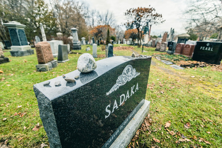 Montreal, Canada _ November 30, 2017. Jewish Graveyard in Montreal on cold day of Autumn. The Shaar Hashomayim Cemetery was established in the mid-1860s on the northern slope of historic Mount Royal. Редакционное