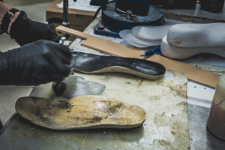 Adjusting an Orthotics Sole by Adding a Piece under the Arch of the Foot