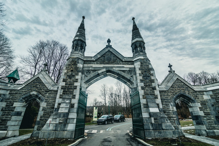 Montreal, Canada _ November 30, 2017. Historic Mount Royal Cemetery Entrance Gate during a Cold Evening of Autumn in Montreal.