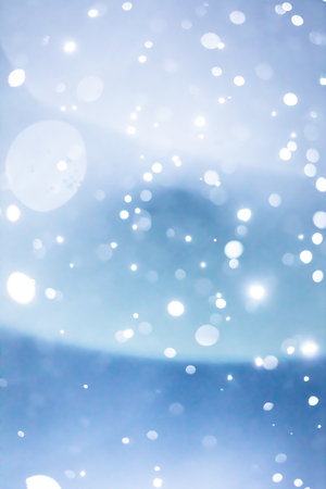 Wet and Smugy Lens Flare and Blurry Snowflakes or Filter Background during Snowstorm at Night