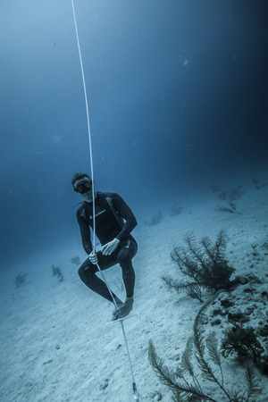 SAN ANDRES ISLAND, Colombia _ Circa March 2017. Freediver at the Bottom of the line Looking at the Corals and doing a Breath Holding