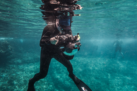 SAN ANDRES ISLAND, Colombia _ Circa March 2017. Freediver Photographer with Large Dome, Camera Housing and camera in Caribbean. Editorial