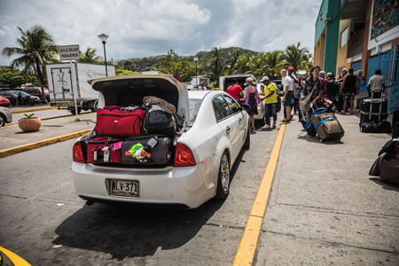 SAN ANDRES ISLAND, Colombia _ Circa March 2017. Colombian Taxi and Shuttles Drivers Waiting for a Batch of Tourists in front of Airport in San Andres Redakční