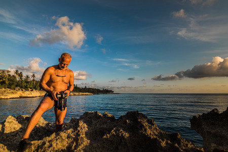 SAN ANDRES ISLAND, Colombia _ Circa March 2017. Photographer Documenting a Beautiful Sunset in the Caribbean