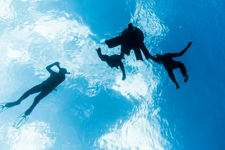 SAN ANDRES ISLAND, Colombia _ Circa March 2017. Freedivers Breathing around the Buoy and Line and Getting Ready for the Next Dive