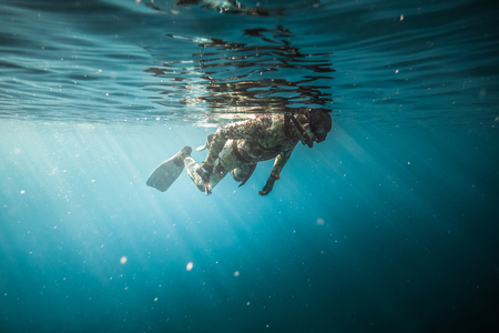 SAN ANDRES ISLAND, Colombia _ Circa March 2017. Freediver Breathing at the surface and Getting Ready for the Next Dive