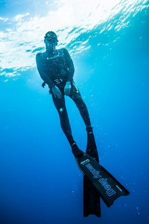 SAN ANDRES ISLAND, Colombia _ Circa March 2017. Freediver Diving and Following the Life Line at all time in the Deep Blue of San Andres Island, Colombia.