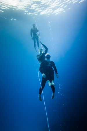 SAN ANDRES ISLAND, Colombia _ Circa March 2017. Freediving Rescue Technique and Simulation of a Diver after Blackout.