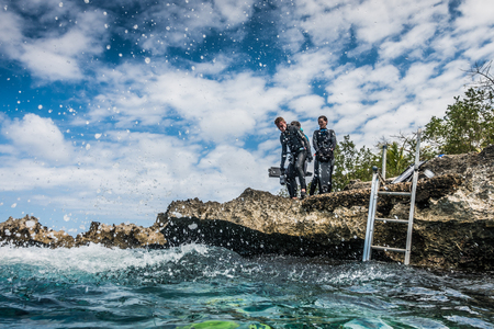 SAN ANDRES ISLAND, Colombia _ Circa March 2017. Group of Freedivers Getting into the Water from the Shore Line in San Andres Island. Editorial