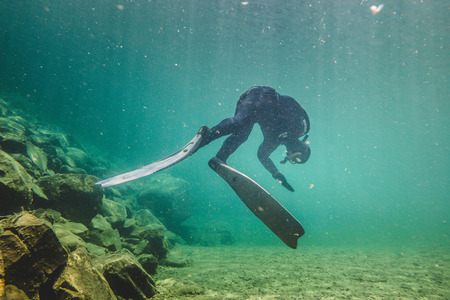 BONAVENTURE, CANADA _ JULY 19, 2017. Freediver Letting hiself go with the Strong Current of The Bonaventure River