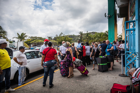 SAN ANDRES ISLAND, Colombia _ Circa March 2017. Colombian Taxi and Shuttles Drivers Waiting for a Batch of Tourists in front of Airport in San Andres Redactioneel