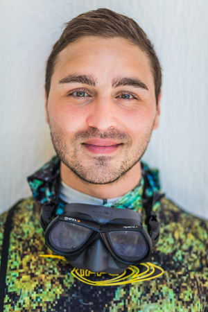 SAN ANDRES ISLAND, Colombia _ Circa March 2017. Funny Smiling  Freediver Portrait after 7 days of Diving and Raccoon Sunburn Print. Editorial