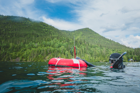 GASPESIE, CANADA _ JULY 20, 2017. Freediver at the Buoy and Getting Ready for the next Dive