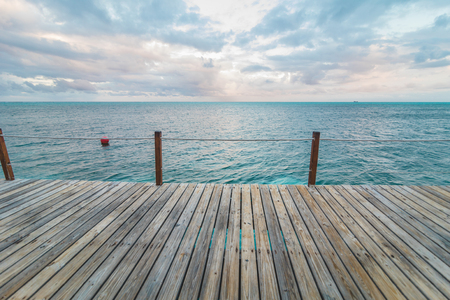 Wooden Pier and Turquoise Caribbean Ocean in Background