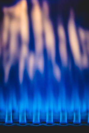 Close-up shot of beautiful blue and red colorful flame of burning gas in industrial heater