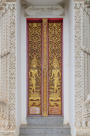 Carved doors  The Story of Buddhism photo