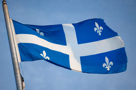 Canada, Quebec, provincial flag flying in the wind