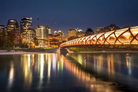 Peace Bridge at night over the Bow Rover in Calgary Alberta Canada