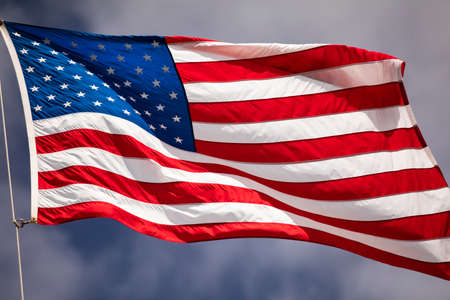Flag of the USA flies in the wind