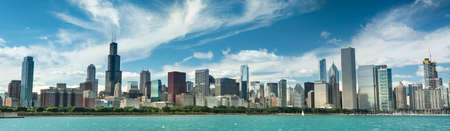 Chicago cityscape panoramic looking out from the Adler Planetarium across Lake Michigan in Illinois USA