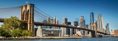 East River shoreline boardwalk under the Brooklyn Bridge as seen from the DUMBO area in New York USA