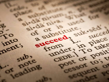 Succeed in the pages of an English dictionary Stock Photo