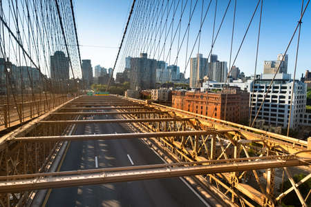 Traffic moves across the Brooklyn Bridge connecting Manhattan New York City over the East River