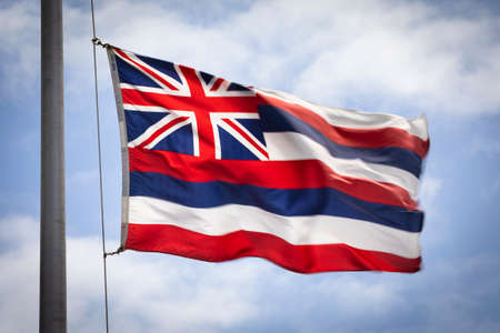 Hawaiian state flag in the wind on Oahu Hawaii USA 写真素材