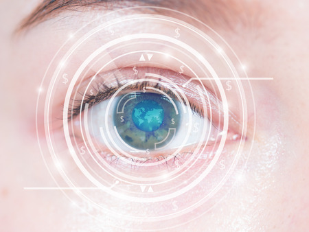 Close-up of woman's blue eye. High technology in the futuristic. scan, contact lens Banque d'images