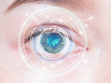 Close-up of woman's blue eye. High technology in the futuristic. scan, contact lens Banco de Imagens