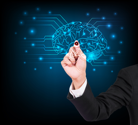 Businessman hand writing and drawing brain on a touch screen interface