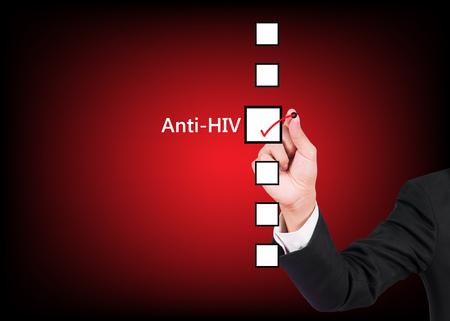 Hand holding pen choosing anti HIV of six options