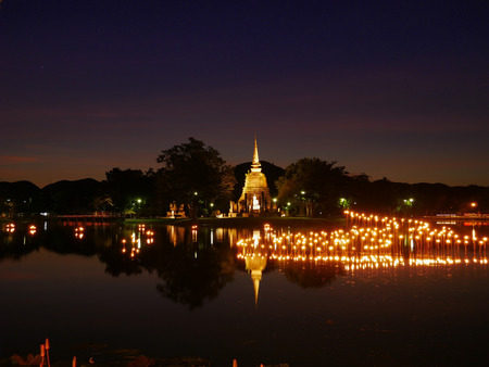 light in Buddha Statue at Temple in Loy Kratong Festival, Sukhothai Historical park , Thailand