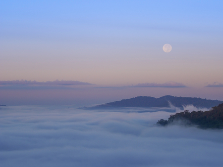 fog in the morning with mountain and moon at Khao Kho, Phetchabun, Thailand