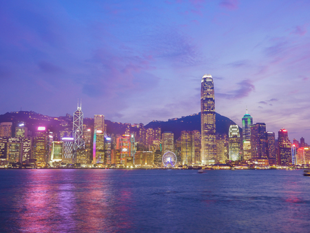 Skyline of Hong Kong city at twilight time, view from Victoria Harbour