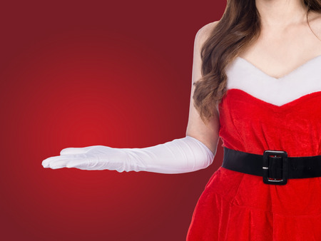 young christmas girl holding something on red background