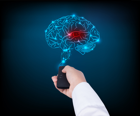 woman holding TV remote control with brain on blue background Stock Photo